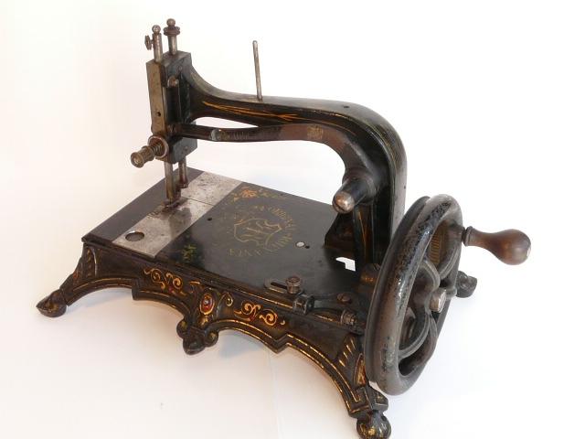 máquinas antiguas de coser historia